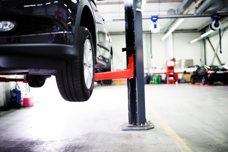 Car on lift at car service